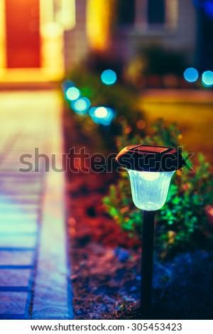 small solar garden light lanterns in flower bed garden design solar powered lamp - Solar Powered Lanterns
