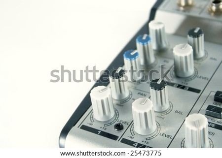 Small sound mixer and preamp on white background