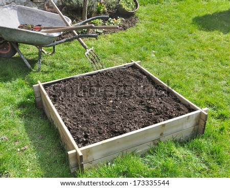 small square filled with soil for vegetable garden  - stock photo