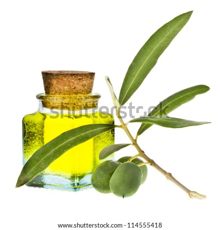 small square glass bottle with olive oil, decorated with a small twig with green olives, fruit, isolated on white background - stock photo