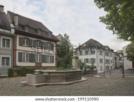 Small square with old fountain in Basel, Switzerland - stock photo