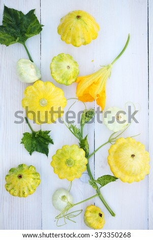 Small squash in a basket on a white table - stock photo