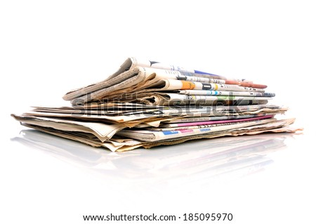 Small stack of international newspapers on white background - stock photo