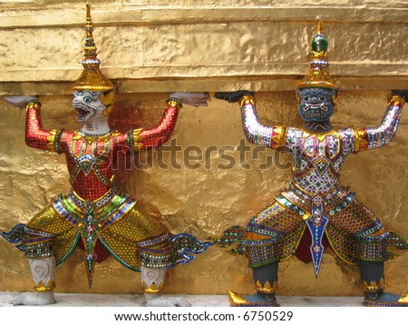Small statues of rakshas at Wat Phra Kaeo, Bangkok, Thailand