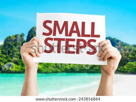 Small Steps card with a beach on background - stock photo