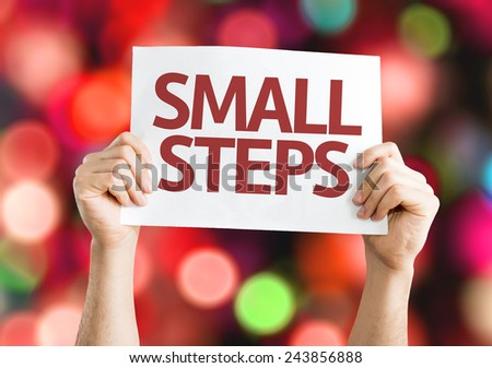 Small Steps card with colorful background with defocused lights - stock photo