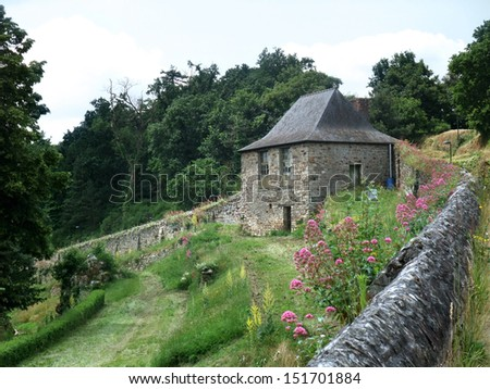 small stone building and wall seen in France - stock photo
