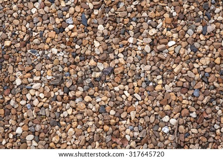 Small stones in concrete footpath texture - stock photo