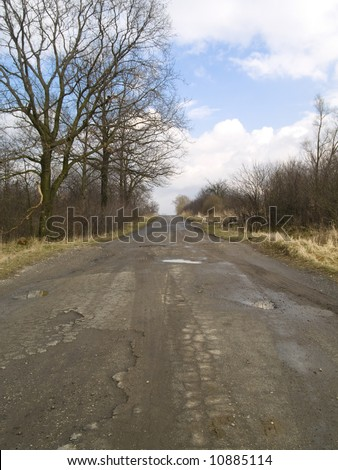 Small straight rural route. No very good. Blue sky and white clouds. - stock photo