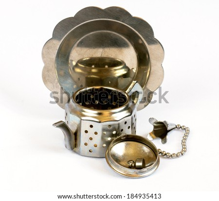 small strainer-teapot for tea leaves with a metal sau?er