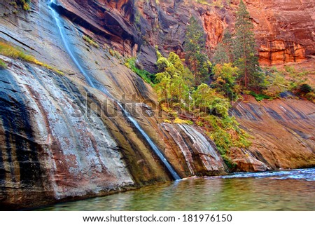 Small stream flows into Virgin River Narrows in Zion National Park Utah - stock photo
