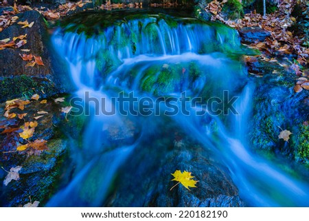 Small stream running through stones during fall foliage, Stowe, Vermont, USA - stock photo