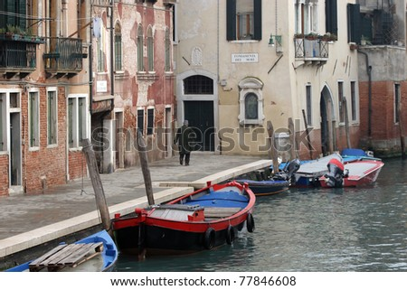 Small street with the canal in Venice, Italy.