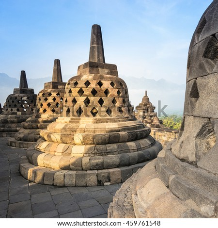small stupa around top of Borobudor, world largest buddhist temple in Yogyakarta, Indonesia. Picture taken with the sunrise.