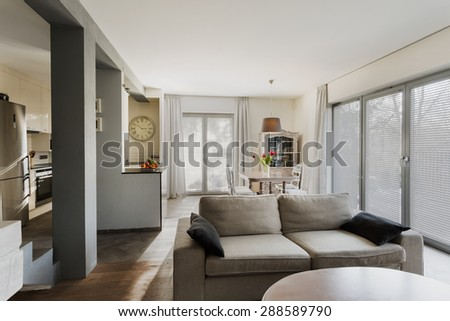 Small stylish lounge connected with dining hall - stock photo