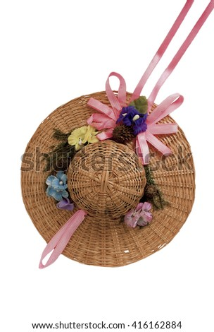 Small summer straw hat for doll isolated over white background - stock photo