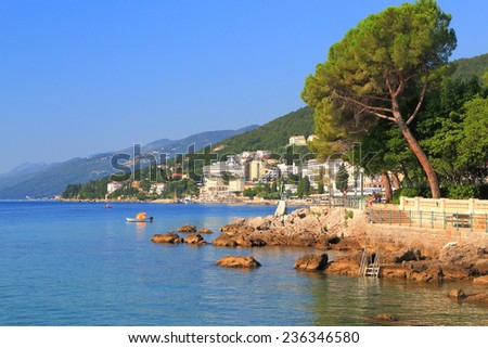 Small sunny beaches with green vegetation near the sea, Opatija, Croatia - stock photo