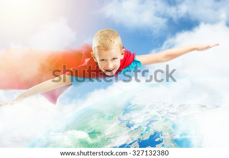 Small superhero boy flying over the Earth. Elements of this image furnished by NASA - stock photo