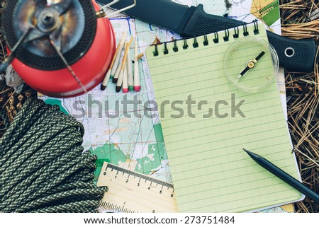 small survival kit in the wild - stock photo