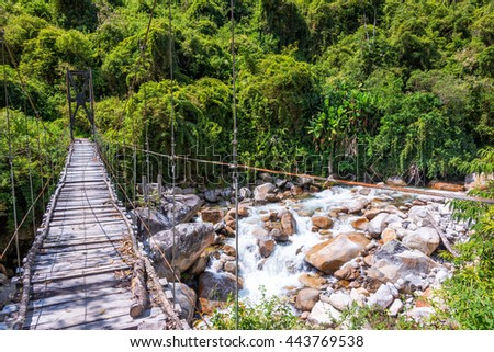 Small suspension bridge in the jungle near Coroico, Bolivia - stock photo