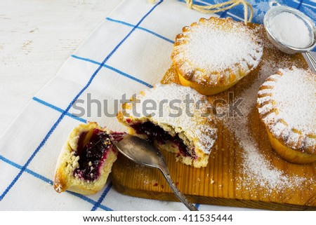 Small sweet pie on the cutting board. Jam pie. Small pie. Pie. Sweet pastry. Sweet dessert  - stock photo