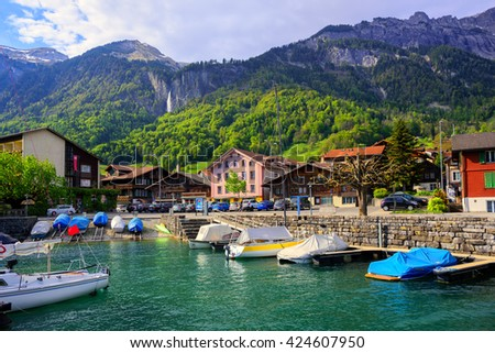 Small swiss town on Lake Brienz near Interlaken surrounded by Alps mountains, Switzerland