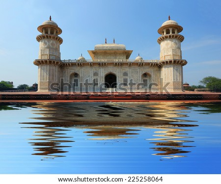 Small Taj Mahal Temple, Agra. Reflection on the water. India. - stock photo