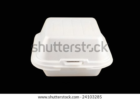 small take-out food container isolated on a black background - stock photo