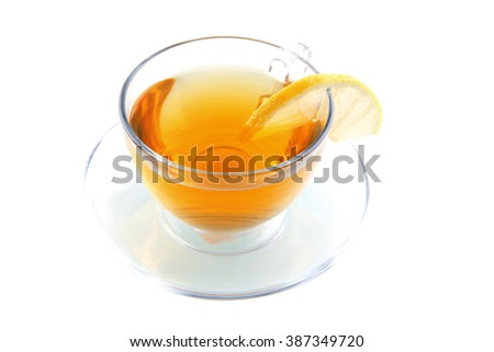 small tea cup with lemon on white