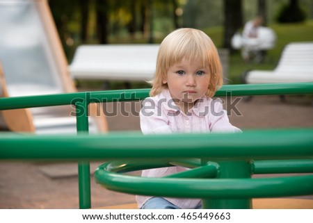 Small toddler girl on the playground