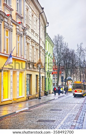 Small Tourist Tram in Pilies Street in the Old Town of Vilnius in Lithuania at Christmas in winter - stock photo
