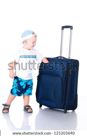 Small tourist with suitcase on white background - stock photo