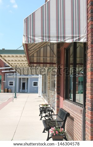 Small town America sidewalk scene showing storefronts. - stock photo
