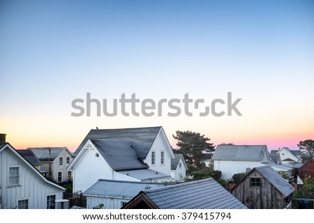 Small town America view of rooftops in early morning light. Copy space - stock photo
