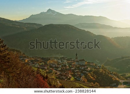 Small town in Trentino area, northern Italy, Alps in the background - stock photo