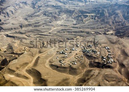 Small town on Negev desert seen from above, Israel, Middle East - stock photo