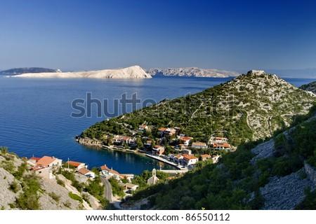 Small town Starigrad kod Senja and the island Goli otok - stock photo