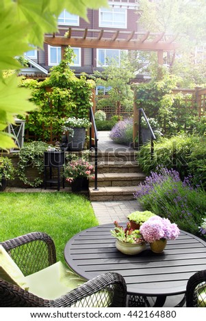 Small townhouse perennial summer garden. Also available in horizontal.