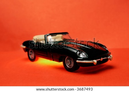 Small toy metal prototype of old car with vinyl highlighting
