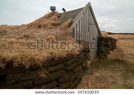 Small traditional turf house in iceland - stock photo