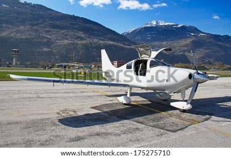 small training aircraft on the airfield - stock photo