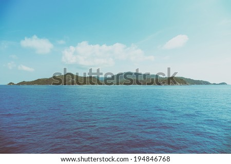 Small tropical island, vintage toned - stock photo