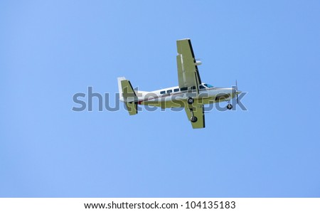 Small turboprop airplane in flight
