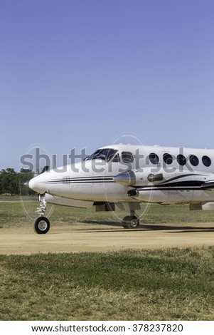 Small twin engined aircraft on a runway - stock photo