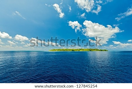 Small uninhabited island in the Indian Ocean, Maldives - stock photo