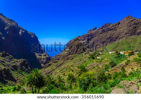 Small Village and Buildings in Green Mountains Landscape on Tenerife Island at Day