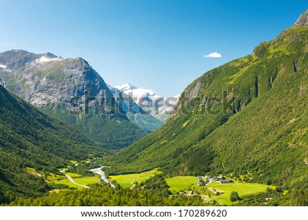 Small village in a valley in mountains, Norway - stock photo