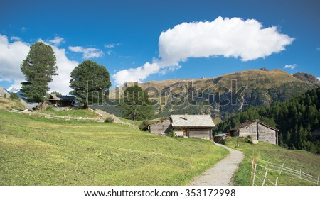 Small village in a valley in the swiss Alps - stock photo