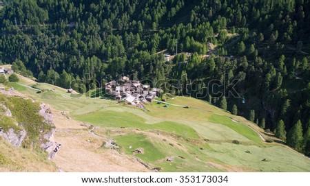 Small village in a valley in the swiss Alps, Zermatt - stock photo
