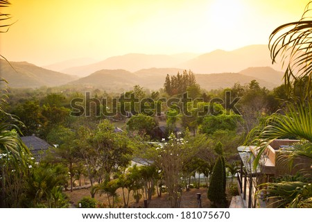 Small village in natural environment among mountains - stock photo